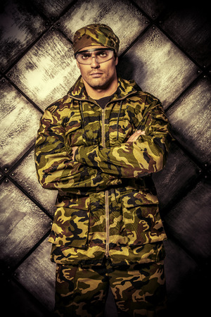 brawny: Masculine soldier in camouflage. Military, war. Stock Photo