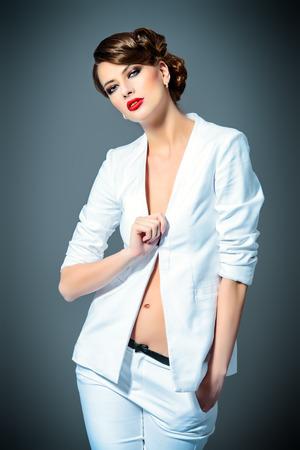 gorgeous businesswoman: Fashion shot of a beautiful model posing at studio. Beauty, fashion. Make-up.