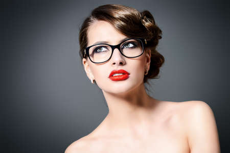 eyewear: Close-up portrait of a gorgeous young woman wearing glasses. Beauty, fashion. Make-up. Optics, eyewear. Stock Photo