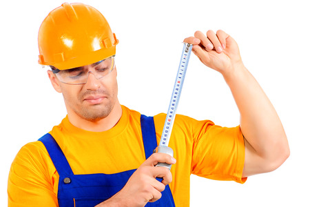 job occupation: A construction worker working with tape measure. Job, occupation. Isolated over white. Stock Photo
