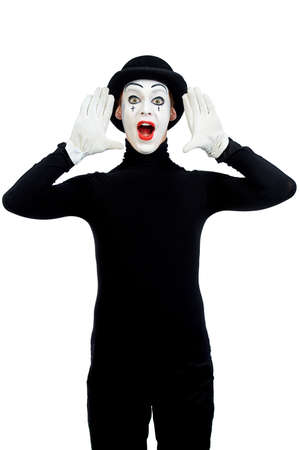 mime: Male mime artist is shouting or calling someone. Isolated over white.