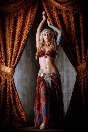 belly dance: Beautiful traditional female dancer. Ethnic dance. Belly dancing. Tribal dancing.