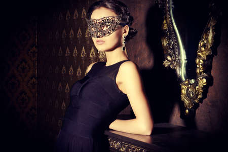 venetian mask: Beautiful mysterious stranger girl in venetian mask. Carnival, masquerade. Jewellery, gems. Stock Photo