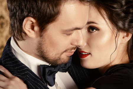 lip kiss: Close-up portrait of a beautiful man and woman in love. Fashion. Love concept.