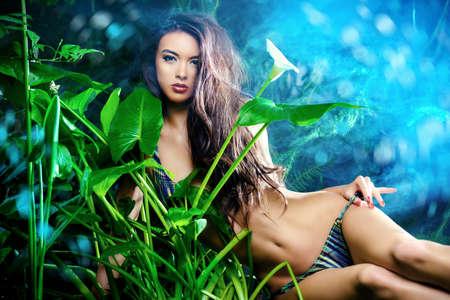 beautiful girl: Beautiful sexy woman in bikini among tropical plants. Beauty, fashion. Spa, healthcare. Tropical vacation.