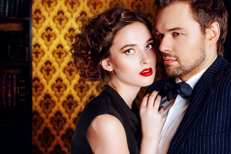 sexy fashion: Close-up portrait of a beautiful man and woman in love. Fashion. Love concept.