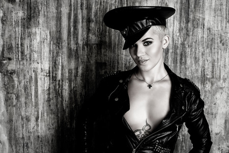 Attractive young woman alluring in a costume of police officer. Black-and-white portrait. photo