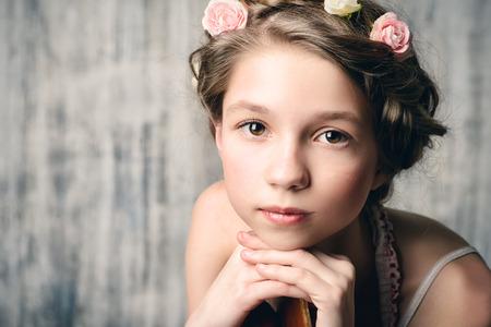 trenzas en el cabello: Vintage potrait of a beautiful girl with braided hair wearing summer sundress. Children fashion. Retro style.