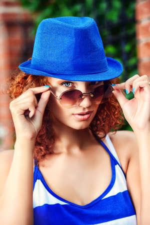 foxy: Attractive young woman beautiful foxy hair outdoors. Beauty, fashion.