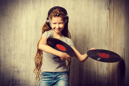 cute teen: Cute happy teen girl enjoys the music in headphones. Generation. Studio shot.