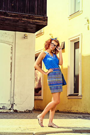 red hair woman: Pretty pin-up girl walking in the city. Beauty, fashion. Stock Photo