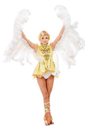 gogo girl: Elegante Tänzerin posiert im Studio in einem schönen Kostüm mit Flügeln. Balletttänzer. Show-Ballett. Karneval. Isolierte über weiß. Lizenzfreie Bilder