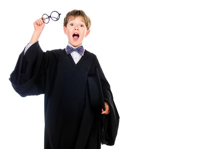 graduation suit: Portrait of a surprised student boy in graduation suit. Educational concept. Isolated over white.
