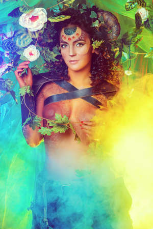 fairy garden: Fabulous female Faun in a fairy garden. Fantasy world. Body painting project.