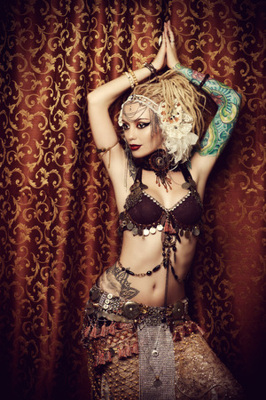 indian headdress: Beautiful traditional female dancer. Ethnic dance. Belly dancing. Tribal dancing.