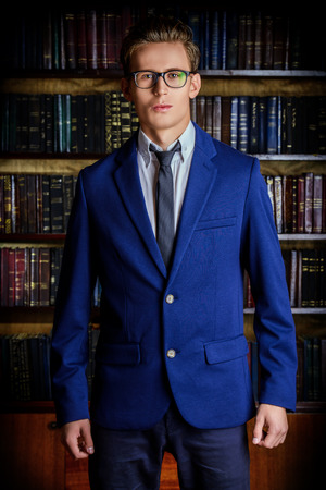 specs: Close-up portrait of a respectable handsome man in his cabinet, library. Classic vintage style. Stock Photo