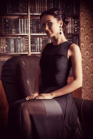 temptation: Beautiful elegant lady in vintage interior. Fashion shot.