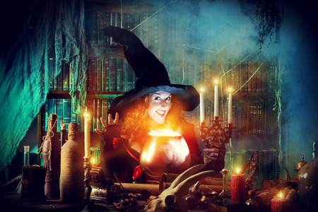 boiling pot: Attractive witch in the wizarding lair. Fairytales. Halloween.