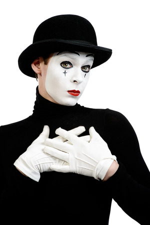 mime: Romantic mime artist puts his hands to his heart performing love. Isolated over white. Stock Photo