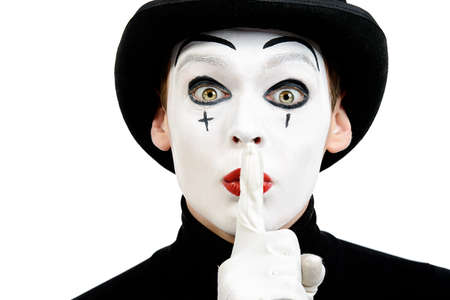 secret: Close-up portrait of a male mime artist showing secret. Isolated over white.