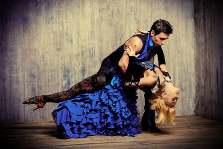 Two beautiful dancers perform the tango, Latin American dance Stock Photo