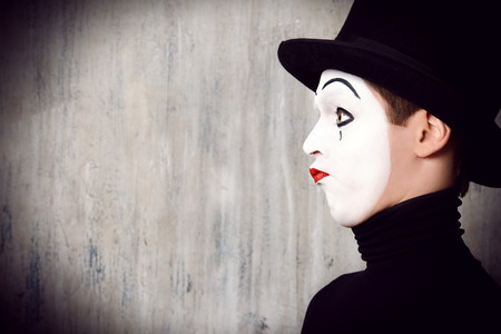 acting: Portrait in profile of a male mime artist performing different emotions