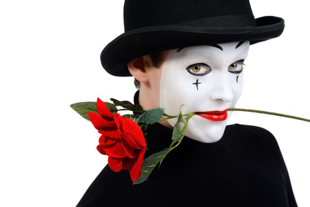 mime: Emotional male mime artist with red rose performing love. Isolated over white. Stock Photo