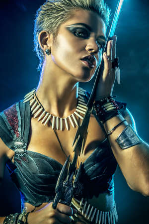 ancient times: Portrait of a beautiful female warrior in battle. Ancient times. Amazon. Stock Photo