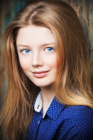 child portrait: Portrait of a cute smiling teen girl looking at camera.