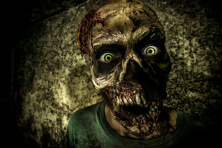 scared face: Close-up portrait of a horrible scary zombie man. Horror. Halloween. Stock Photo