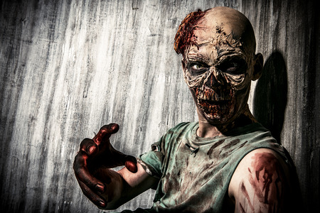 horror: Close-up portrait of a horrible scary zombie man. Horror. Halloween. Stock Photo