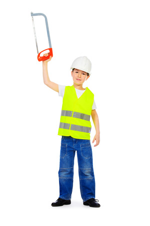 eight years old: Eight years old boy in a costume of a builder posing with a saw. Isolated over white. Full length portrait.