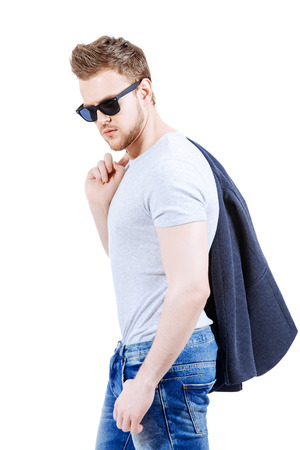 adult boys: Portrait of confident young man wearing jeans and jacket. Mens beauty, fashion. Isolated over white.
