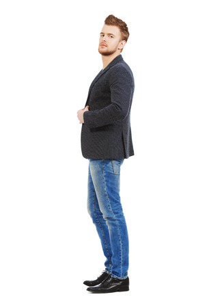 good looking model: Full length portrait of casual young man wearing jeans and jacket. Mens beauty, fashion. Isolated over white.