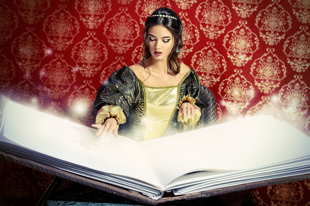 old style: Fairy beautiful witch reads magic book of spells. Vintage style. Renaissance. Barocco. Halloween.