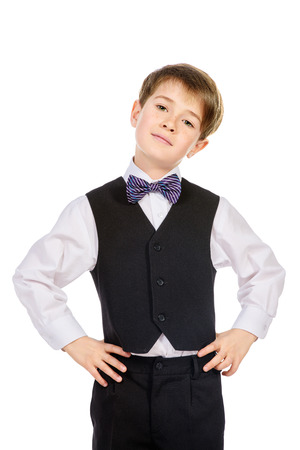male model: Portrait of a boy in a suit. Fashion kids. Education. Isolated over white.