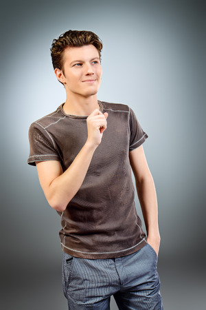 good looking model: Portrait of a cheerful young man in casual clothes. Mens beauty, fashion. Studio shot.