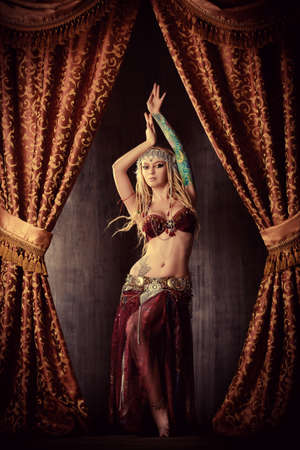 belly dancer: Beautiful traditional female dancer. Ethnic dance. Belly dancing. Tribal dancing.