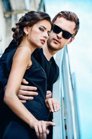 men and women: Fashion style photo of a beautiful couple over city background. Stock Photo