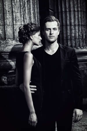 luxury lifestyle: Black-and-white portrait of a beautiful man and woman. Fashion style photo. Love concept. Stock Photo