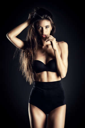 bra model: Beautiful slender woman alluring in black sexy lingerie. Fashion studio shot. Stock Photo