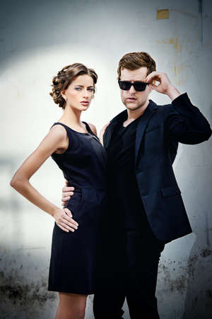 male fashion model: Fashion style photo of a beautiful couple over city background. Stock Photo