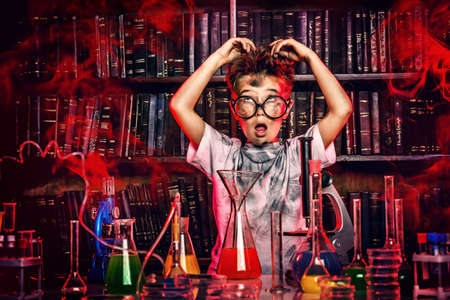 science experiment: A boy doing experiments in the laboratory. Explosion in the laboratory. Science and education.