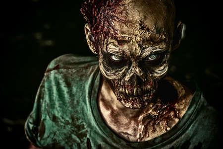 fear: Close-up portrait of a horrible scary zombie man. Horror. Halloween. Stock Photo