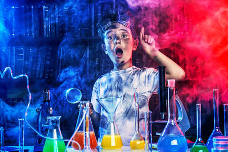 laboratory: A boy doing experiments in the laboratory. Explosion in the laboratory. Science and education.