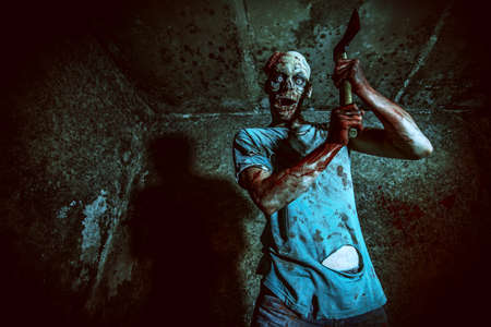 horror: Horrible scary zombie man on the ruins of an old house. Horror. Halloween.