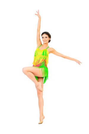 latin dance: Beautiful professional female dancer dancing at studio. Latin American dances. Isolated over white. Stock Photo