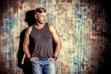 sportive: Portrait of a handsome man  over grunge background.