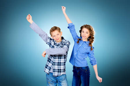 happy teenagers: Happy teenagers posing together. Active generation.  Education. Studio shot.