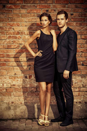 women and men: Fashion style photo of a beautiful couple over city background. Stock Photo